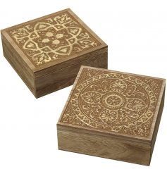 A beautifully vintage inspired assortment of natural wooden boxes featuring assorted carved patterns