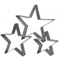 A set of thee metal stars perfect to hang or arrange on a shelf this Christmas.