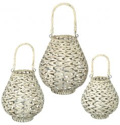 A gorgeous set of assorted sized woven lanterns in a chic cream tone