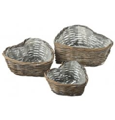 A gorgeous set of heart shaped woven wicker baskets