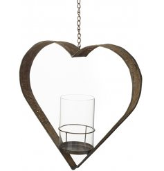 A glass T-light holder in the centre of a large metal heart with woven effect. A charming feature for a rustic home.