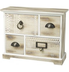A shabby chic style storage unit with blonde wood, white carved detailing and an assortment of vintage style handles.