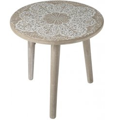 Stood on 3 wooden legs, this table top features a delicate mandala inspired print