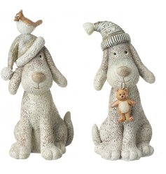 An adorable duo of sitting resin dog figures dressed up in bobble hats