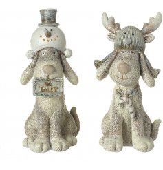 An adorable duo of sitting resin dog figures dressed up in snowman and reindeer themed hats