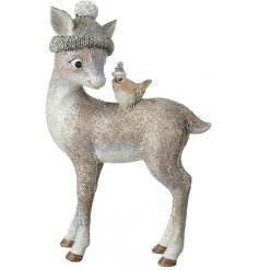 A cute resin deer figure in a knitted green hat