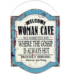 An overly distressed metal plaque featuring a bold text decal and Womans Cave inspired theme