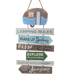 A large wooden hanging plaque featuring tiered rules when camping!