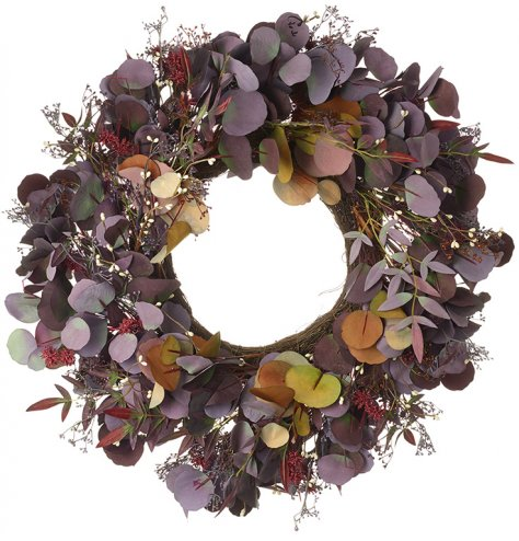 Create an impact with this large and full purple and russet coloured wreath bursting with leaves, grass and buds.