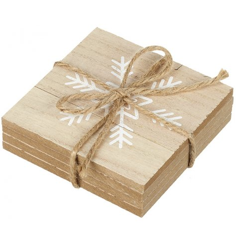 A set of 4 square wooden coasters, each with a painted snowflake stencil.