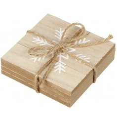 A set of 4 natural wooden coasters, each decorated with a shabby chic snowflake pattern