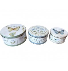 A charming set of 3 sized tins each decorated with a distressed butterfly patterned decal