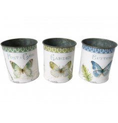 A charming set of round metal planters each decorated with its own butterfly decal and distressed finish