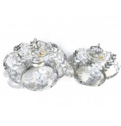 A charming set of whitewashed metal crowns with an added shabby chic feel