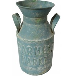 Distressed blue milk churn with added embossed text