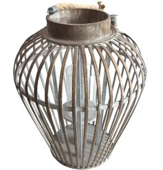 With a distressed setting and oval shaped finish, this wide topped lantern will be sure to place perfectly in any home s