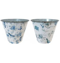 A delightful assortment of blue toned metal vases decorated with a Bird & Butterflies inspired print