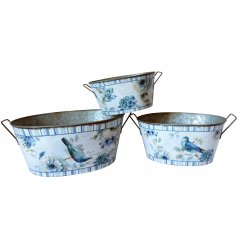 A beautiful set of sized planters each decorated with a charming blue toned pattern