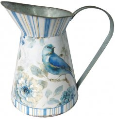 A charming metal jug with an added blue bird decal and rustic finish