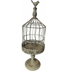An overly distressed metal bird cage decoration, perfect for using as a planter or Tlight holder
