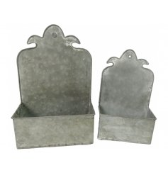 An assorted sized set of square shaped planters with added high edges