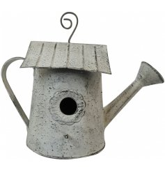A shabby chic inspired hanging metal watering car that also doubles as a cozy birds house!