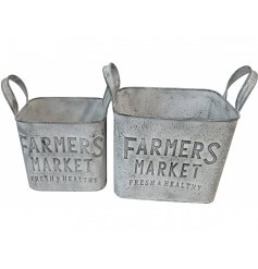a set of 2 distressed planters in a grey tone
