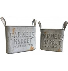 A charming set of overly distressed metal planters complete with embossed Farmers Market texts