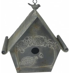 A distressed metal hanging bird house, beautifully decorated with an embossed flower decal and added curved roof finish