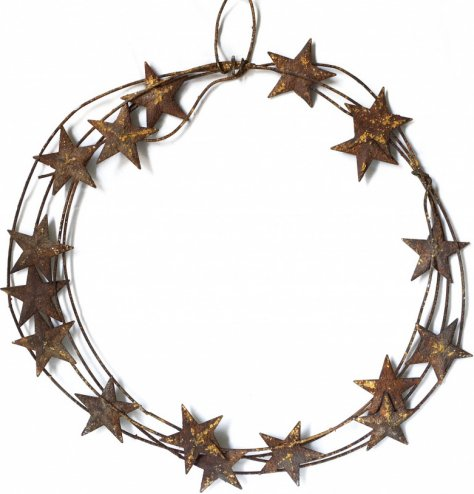 A heavily distressed metal wreath with rusted metal star detail.