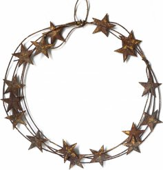 A distressed round metal wreath with an added rustic star decal