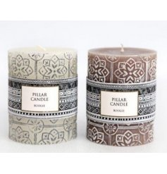 A mix of cream and mink toned wax candles with added printed decals