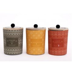 A mix of 3 small glass candle pots featuring different colours and patterns