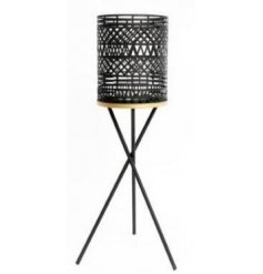 Bring a contemporary charm to any home space with this Luxe tripod based candle holder