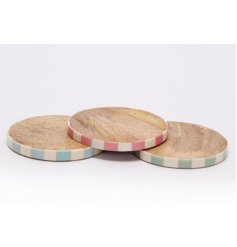 A set of natural wooden coasters, perfectly set with a pastel toned stripe trimming