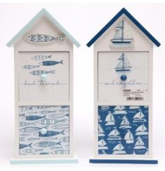 A mix of Coastal inspired wooden draw units, perfectly decorated with light and dark blue tones and patterns