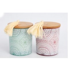 Assorted by their pink and blue glass tones, these beautifully decorated candles also feature a tassel topped lid
