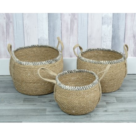 A lovely set of natural storage baskets with a subtle grey trim.