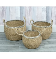 A lovely set of three woven baskets with natural handles and grey trim.