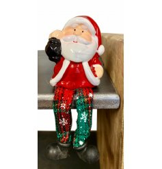 A cute Christmas character shelf sitter with traditional tartan legs.