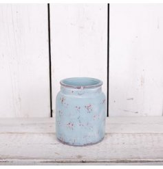 A charming rustic stone pot in pastel blue. Perfect for Spring.