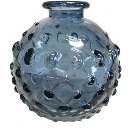 A small decorative vase, set with a dimple ridged decal and coastal blue tone