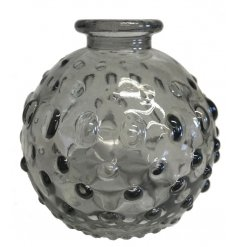 A small decorative vase, set with a dimple ridged decal and neutral grey tone