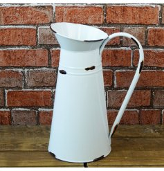 A large decorative jug with an overly distressed white tone and added vintage charm