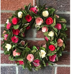 Bring a touch of spring to your home decor or displays with this charming round wreath