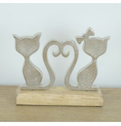 Lovely pair of silver aluminium cats set upon a wooden base.