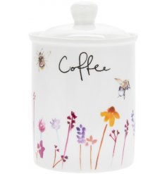 A smooth white ceramic canister with a beautifully printed Busy Bee Garden themed decal and added text
