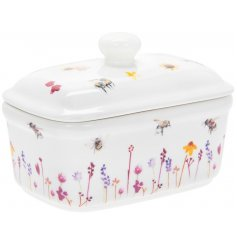 A smooth white ceramic butter dish with a beautifully printed Busy Bee Garden themed decal