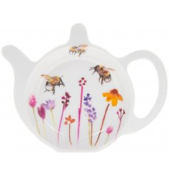 A smooth white plastic teabag tidy with a beautifully printed Busy Bee Garden themed decal