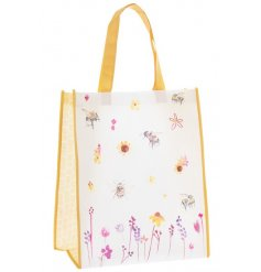 A stylish fabric shopping bag with a yellow tone edging and beautifully printed Busy Bee Garden themed decal